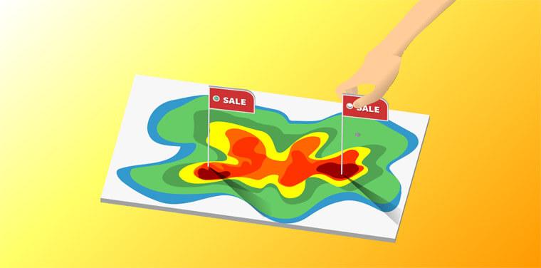 """Mapa de Fluxo de pessoas em uma mesa enquanto uma mão coloca placas de """"sale"""" nos lugares mais apontados"""